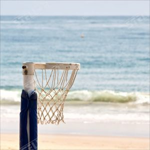 Thumbnail Netball Hoop Close Up Ocean Background positioned left